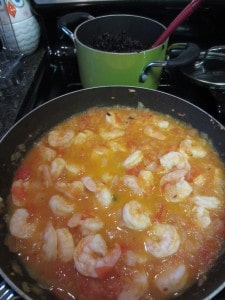 black rice and tomato shrimp cooking