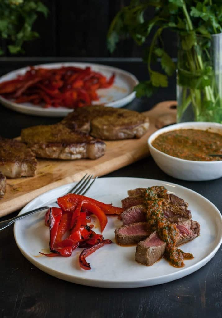 Curry crusted steak with roasted red pepper chimichurri sauce