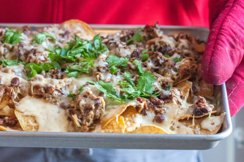 The best nachos ever - pulled pork pinto bean and green chilies nachos
