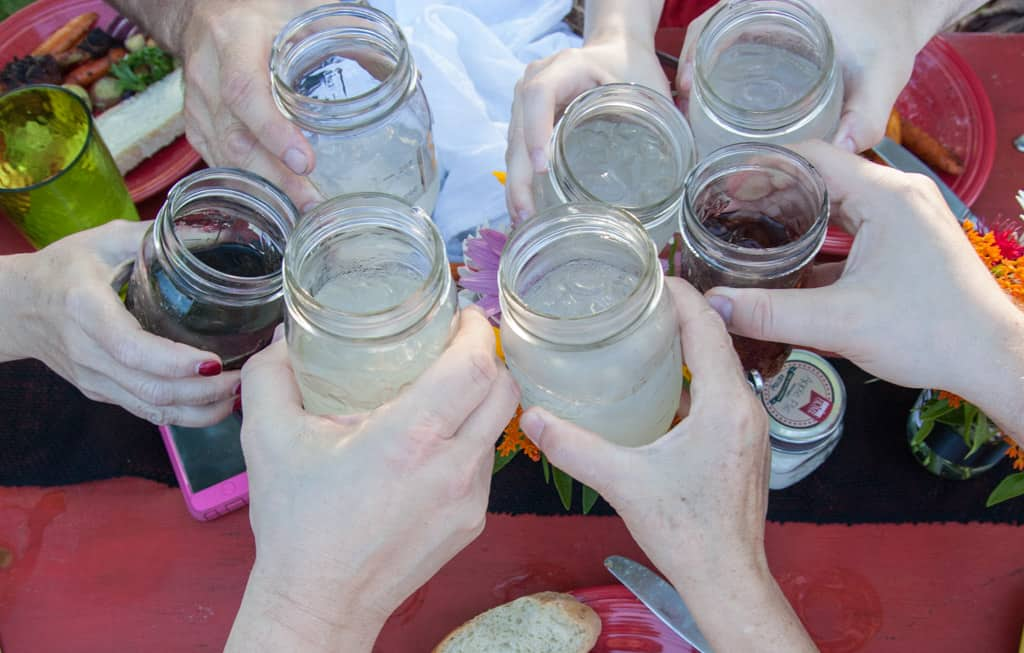 Drinks in mason jars at farm to table dinner