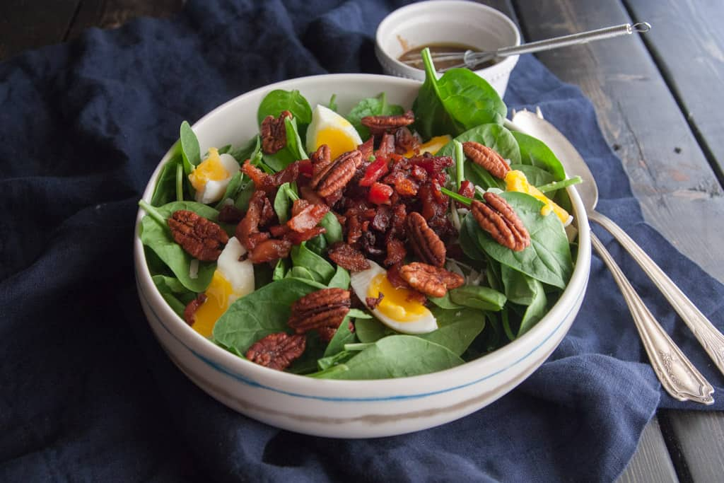 Spinach salad with soft boiled eggs bacon and a mustard vinaigrette from @SweetPhi