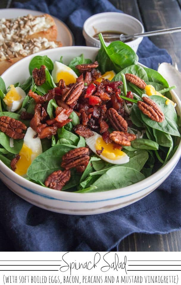 Spinach salad with soft boiled eggs bacon pecans and a mustard vinaigrette from @sweetphi