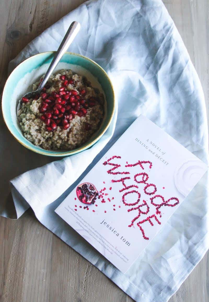 Steel cut oatmeal with pomegranate seeds and Food Whore book