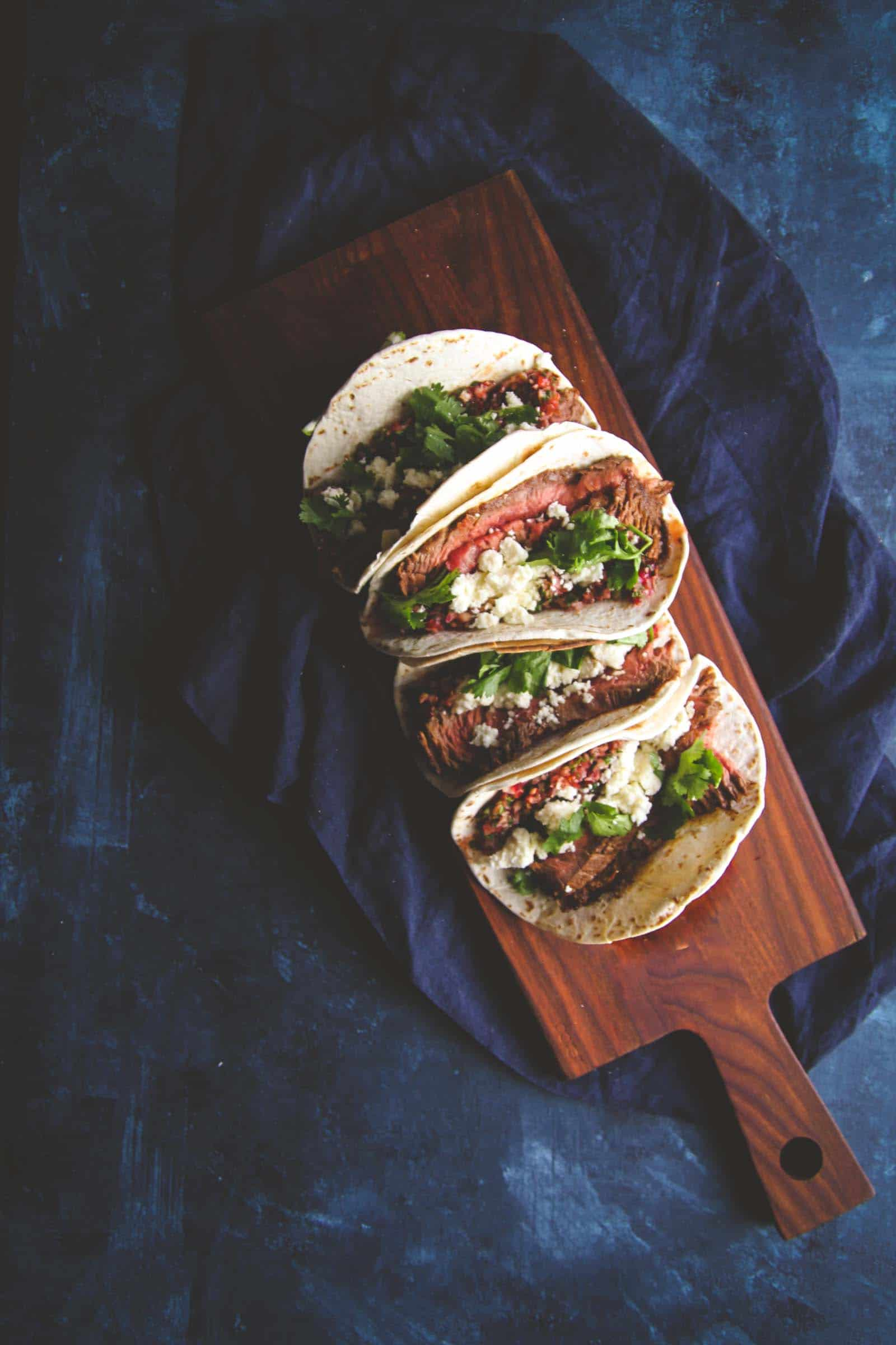 Flank steak tacos with fresh cranberry salsa recipe. Steak tacos for taco Tuesday from @sweetphi