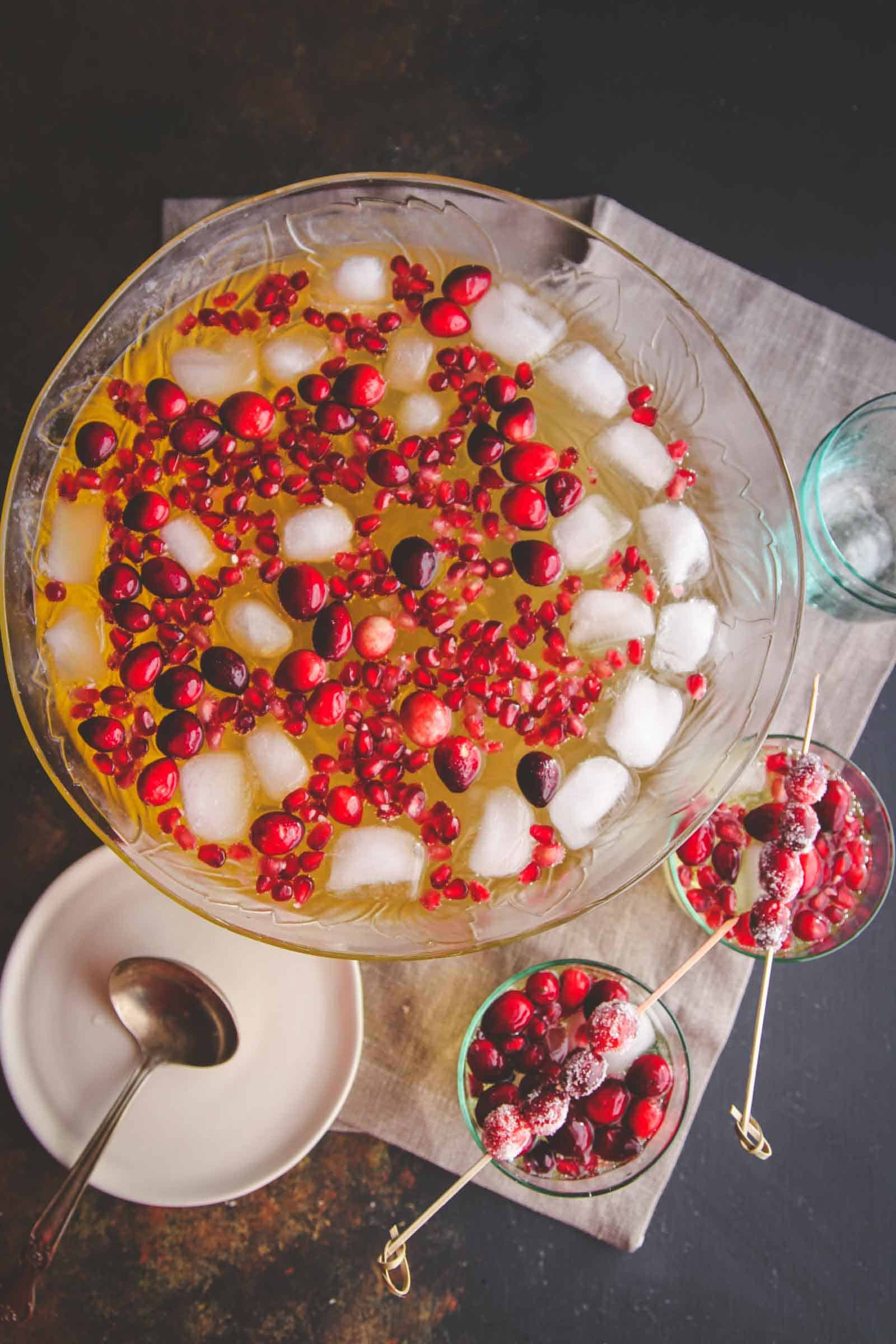 5 ingredient holiday fruit punch with sugared cranberries. A delicious holiday drink recipe