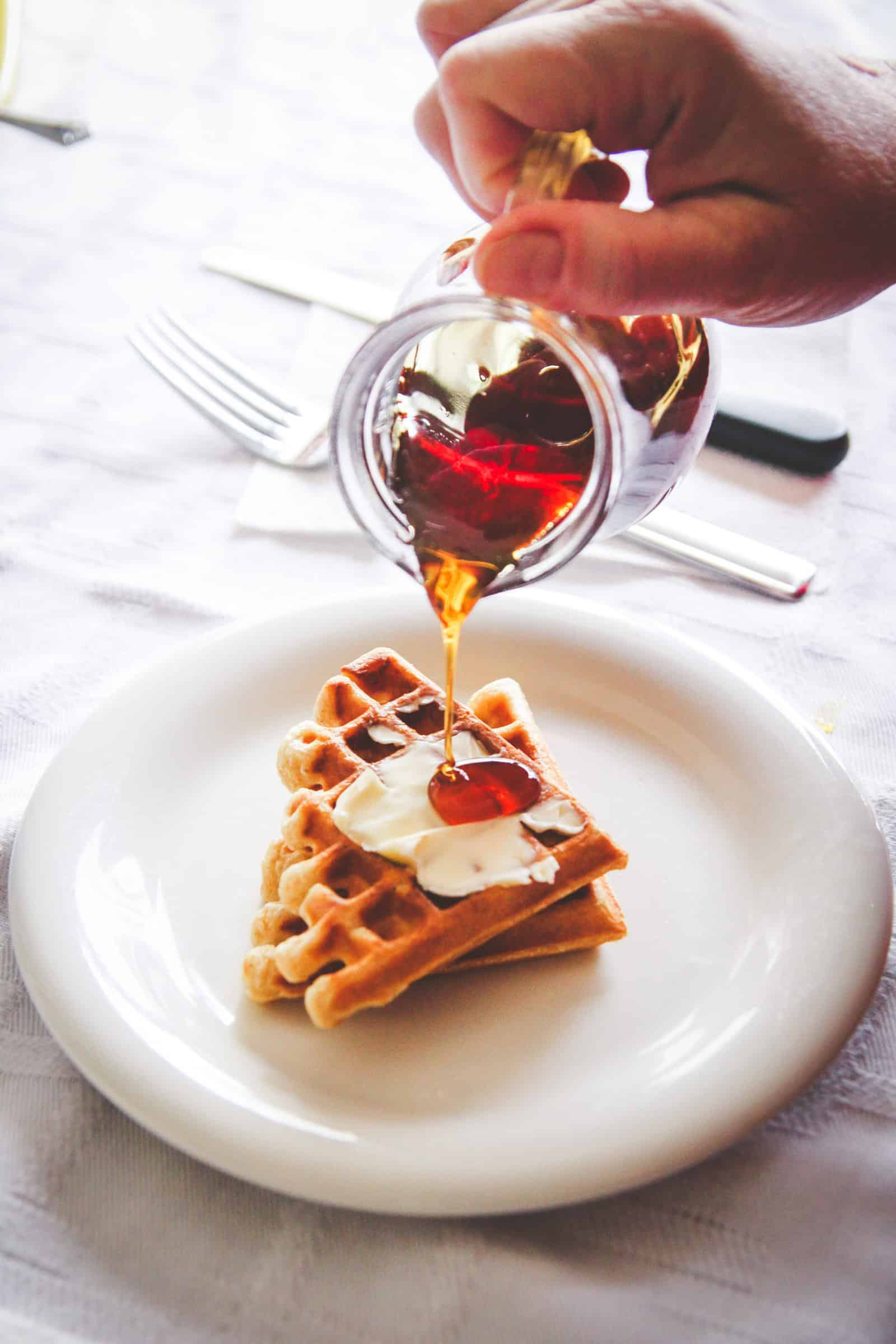 Waffles with butter and maple syrup